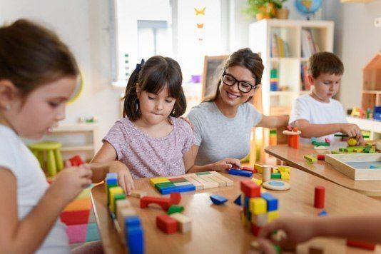 Children playing with bricks at nursery school