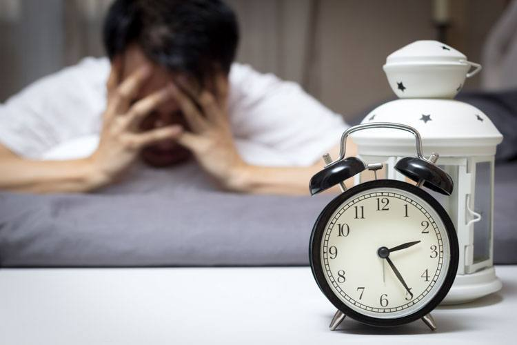 Man having difficulty sleeping during coronavirus crisis